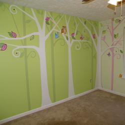 Woodland Wonderland - Designed to coordinate with the linens, this stylized mural has lots of woodland critters excited to meet the little miss that is moving in. -