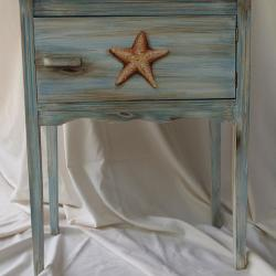 Cigar Cabinet - AFTER - Cigars were traded in for a Seaside Starfish and a weathered finished to be used as added storage in a bathroom. -