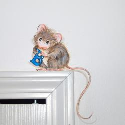 A wee little mouse holds the initial of the bedroom's owner